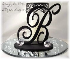 "Centerpiece Idea for long tables. Possibly use an ""M"" or the number ""30"" in gold on mirriors, letters and number can be purchased from craft store possible add balloons for accents. On average ( this would cost possible $5.00 a piece or less )"