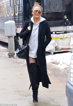 Chic: Chrissy proved her sense of style has not faltered in pregnancy as she stepped out in a trendy oversized grey jumper, which skimmed her bump, and thigh-high stiletto boots