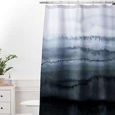 Complete your bathroom with the DENY Designs Monika Strigel Within the Tides Stormy Weather Shower Curtain. This artistic curtain features a stunning design of a stormy sea that is sure to ensure privacy as well as make a statement in your bathroom decor.