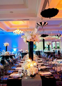 Tall, white centerpieces, black and white parasols  // Photo: Studio563 // Design: Liv by Design