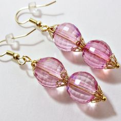 """Pink Petunia earrings by SashaGirls on EtsyThese are cute little czech glass earrings. Nice checker faceting around the whole bead. I place golden bead caps to bring out the sparkle of the pink    Pink czech faceted beads-Checker board faceted    golden bead caps    hypo-allergenic gold ear wires    measures about 2"""" long    Nice earring for a spring day    All my earrings comes with rubber stoppers"""