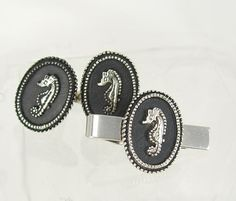 This vintage pair of elegantly designed black enamel seahorse cufflink set including tie clip would be perfect for most any occasion.The