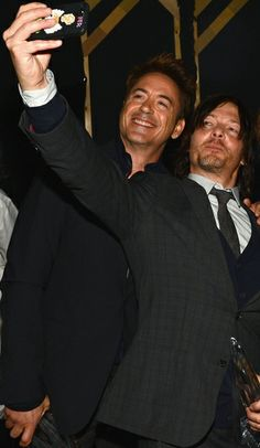 Robert Downey Jr and Norman Reedus at 2014 Peoples Choice Awards.