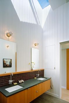 built in storage Malcolm Davis Architecture Bathroom: Remodelista -- good article on bathroom remodel