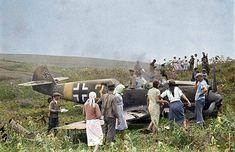 soviet farmers inpect a downed german plane.  messerschitt me bf 109 e-7 yellow 3 of 11/jg 77 first aircraft shot down near tirapol region, southern front june 1941.
