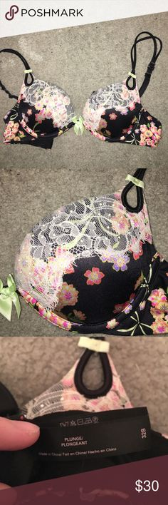VS PLUNGE BLACK FLORAL LACE MULTI-WAY BRA 32B Plunge Victoria's Secret bra, black with green blows, floral patterns, and white lace with little pearls accenting the top of the cups. Can be worn classic, cross back or halter. Way too small for me now! Used to wear this bra. Always hand washed and line dried. Still in practically perfect condition. No flaws. Victoria's Secret Intimates & Sleepwear Bras
