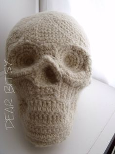 Knitted Skull Pillow  ~~ oh yes, I like this! I'd like a pile of them infact!