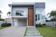 Fachada : Casas modernas por Pau Brasil