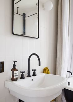 """The modern pedestal sink is thePiazza from Lacava: """"It looks very happy and has good deck space compared to others,"""" notes Thomas. The faucet is the East Linear in flat black from Newport Brass."""
