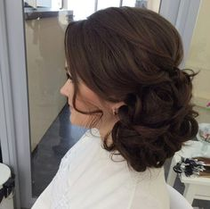 A Muscovite wedding hair salon called Elstile created this look. I love the sweeping layers over her crown and fringe areas, and it just goes to show that even intricate updos aren't lost amongst chocolate coloured locks.
