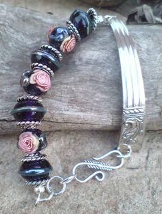 Bracelet, with rose murrini and metal piece