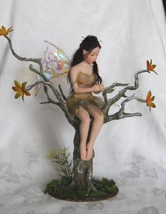 Beautiful polymer clay fairy in a tree