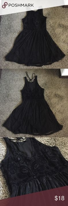 Black velvet lace dress Black lace dress with velvet details, high neck in front and small V in back. Side zipper, tie at the neck in back. Slip underneath. Worn a few times to work Hollister Dresses