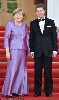Angela Merkel and her husband Joachim Sauer pose for photographs