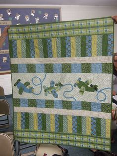 Great quilt for a little boy. And the contrails are made using rick rack. That is adorable