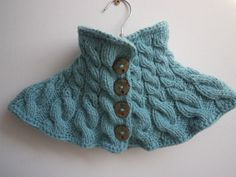 Blue cotton neck warmer with bamboo buttons.