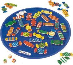 Candy is een zoekspel waarbij de kinderen kleurencombinaties leren herkennen. Op tafel ligt een groot houten bord vol heerlijke snoepjes. Alle snoepjes bestaan uit één, twee of drie kleuren. Er zijn drie kleurendobbelstenen in het spel. Om beurt gooien met de spelers de drie dobbelstenen. Daarna begint het zoekwerk, want er moet een snoepje gezocht worden met dezelfde kleuren van de dobbelstenen.