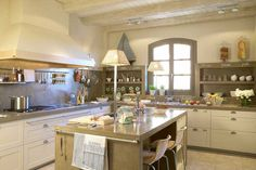 built-in open shelving + scripted organization + white cabinets + island towel bar + range design in kitchen by Deulonder