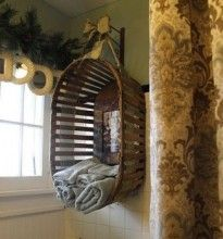 Hanging a basket sideways against the wall is a unique and sort of shabby-chic way to store towels. ~ Home Ideas