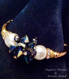 We love this elegant Swarovski clear and Blue Montana Crystal and Pearl bangle bracelet by Alexandra Marshall with 14K Gold overlay and leaf. Magnetic clasp & safety chain. $79. #B1813. Double click photo to visit my web store.