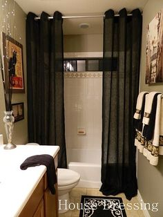"""Floor-to-ceiling shower curtains... why cut the space in half with a curtain hung at the """"normal"""" height, when you can make it like this and make a small bathroom feel more luxurious?"""