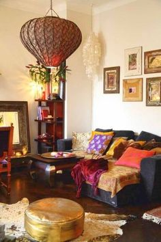 bohemian living. LOVE LOVE LOVE!! This is exactly how I envisioned decorating my room, even. :)