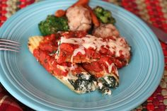 Cannelloni stuffed full of spinach, ricotta, goats cheese, and Parmesan topped with a marinara sauce and mozzarella