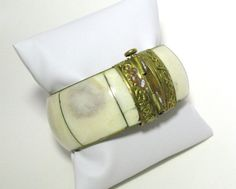 Vintage Bone and Brass Hinged Bangle Bracelet    Measures 9 1/4 inches outside diameter, 7 inch interior diameter and 1 inch tall.    For more Jewels …
