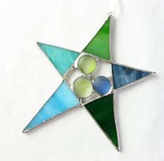 Stained Glass Star Suncatcher Ornament Green Blue. $18.00, via Etsy.