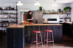 When we first moved into this house (built in 1977), we agreed that the first thing that had to go was the wall dividing the kitchen and living space. It took us three years before knocking it down, but what a difference it made! We built a kitchen island where the wall used to be and created a facade with individually stained strips of wood lattice.