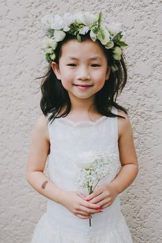 Sweet flower girl with a floral crown  // Photo by Samuel Goh Photography