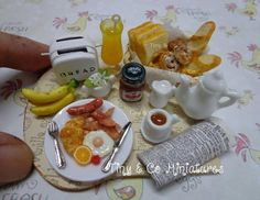 Tiny breakfast with teapot and toaster