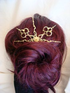 Steampunk Clock Hand Hair Stick. $7.00, via Etsy.