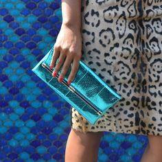 The 400 Envelope Clutch in metallic teal pops against the Vania Pencil Skirt in leopard: http://on.dvf.com/1eHbeEL #DVFsummer