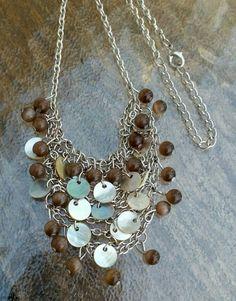 Check out this item in my Etsy shop https://www.etsy.com/listing/263388197/vintage-silvertone-boho-chic-bib
