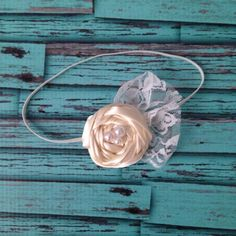 Rosette Flower Headband-Ivory Rosettes-Flower Girl Headband-Photo Prop-Special Occasion-Birthday Headband-Baby Headband-Bridal-Baptism by LosBowtique on Etsy https://www.etsy.com/listing/202121871/rosette-flower-headband-ivory-rosettes