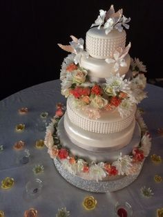 A seven tier wedding cake with each layer a different flavour including chocolate, pistachio, vanilla and orange. The flowers on the table are all hand made sugar flowers, as are the orchids at the top.