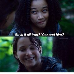 The Hunger Games-Her voice denies it but her smile and eyes say a different story.