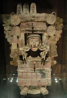 "This great ceramic image of the Aztec goddess Chicomecoatl is in the collection of the Anthropology Museum in Mexico City. her name means ""7 serpents"" Red was her color and she is wearing a large hat made from Wood and covered with bark (amate) paper ""7..."