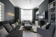 Living room with dark blueish grey walls, stylish dark grey furniture, and huge window. Charcoal Living Rooms, Grey Walls Living Room, Beige Living Rooms, Grey Room, Living Room Colors, Living Room Paint, Living Room Sofa, Interior Design Living Room, Living Room Designs