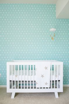 Minimal blue and white polka dot nursery with star bedding