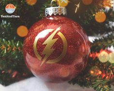 These round, shatterproof acrylic ornaments are filled with red glitter. Flash decal will be yellow unless otherwise noted. The decal can be done in one of the 30 vinyl color choices we offer. Each ornament comes with a gold ribbon and in a small organza gift bag. Size: 3.25 #GlitterOrnaments Winter Christmas, Christmas Bulbs, Christmas Crafts, Christmas Decorations, Christmas 2017, Vinyl Ornaments, Glitter Ornaments, Custom Decals, Vinyl Decals
