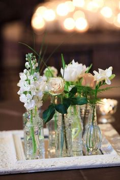 Good idea for the New place...Vintage bottles and frames make beautiful centrepieces.