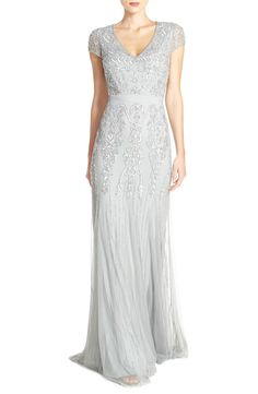 Silvery beads and sequins stream down this gorgeous evening gown made all the more romantic by airy, fluid fabric.