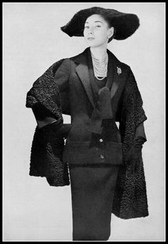 Renée Breton in wool two-piece, dress and jacket featuring an elongated line, worn with astrakhan stole, by Christian Dior, photo by Georges Saad, 1954
