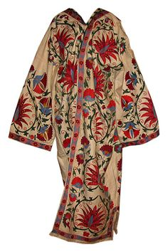 """Dramatic """"suzani"""" from Uzbekistan - a textile of intricate embroidered stitch work created for a girl's dowry. In general suzani are used to decorate and line the tents, or yurts, of Central Asia."""
