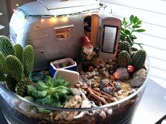 My own version of the Airstream Gnome Garden.  Complete with dye-cast airstream trailer, igloo cooler with ice cubes and coke bottles, garden hose, yard flamingo, steer skull, working christmas lights, camper lights and working camp fire. All the plants are living cactus or succulents. *Inspired by http://www.lushlittlelandscapes.com/2012/08/airstream-miniature-succulent-garden/