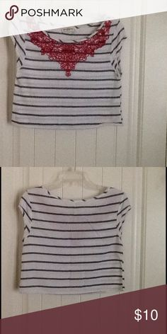 Abercrombie & Fitch Striped Embroidered Crop Top Features of this top are as follows: •Top measures 17.5 inches in total length (from top of shoulder to hem)  •Sleeves measure 3 inches in length  •Bust measures 17 inches across If you have any further questions, please feel free to ask! Abercrombie & Fitch Tops Crop Tops