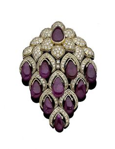 A ruby and diamond floral brooch