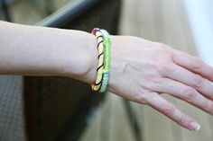 Colorful Fabric Wrapped DIY Bangle | This colorful bangle is a real stunner when it comes to creating a DIY friendship bracelet that is unique!